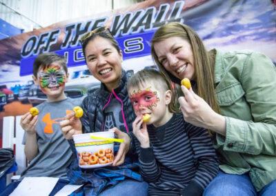 Eating mini donuts, Royal Manitoba Winter Fair, Brandon