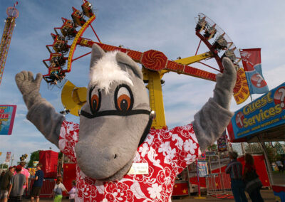 Mascot in front of a ride