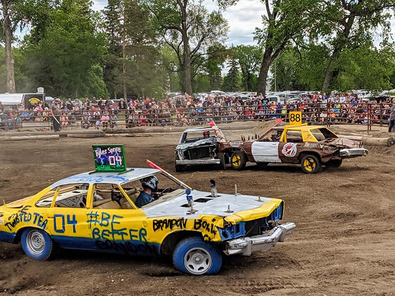 Cars compete in the Demolition Derby at the Manitoba Summer Fair, Brandon, Manitoba