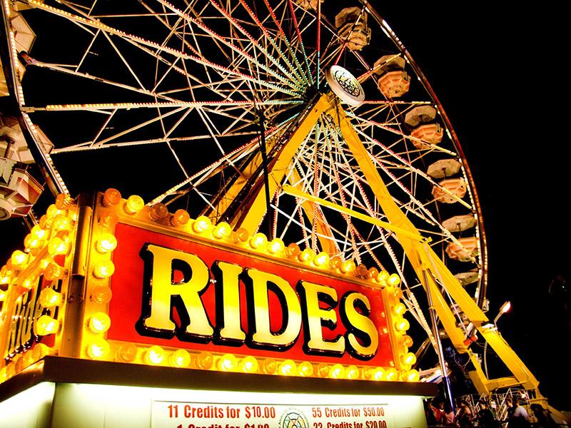 "Close up of the ""Rides"" sign on the Midway at the Manitoba Summer Fair, Brandon, Manitoba"