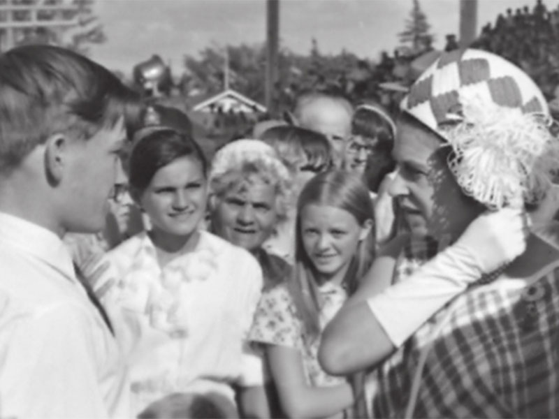 Queen Elizabeth II speaks with an unnamed fairgoer during the Manitoba Summer Fair, July 12, 1970
