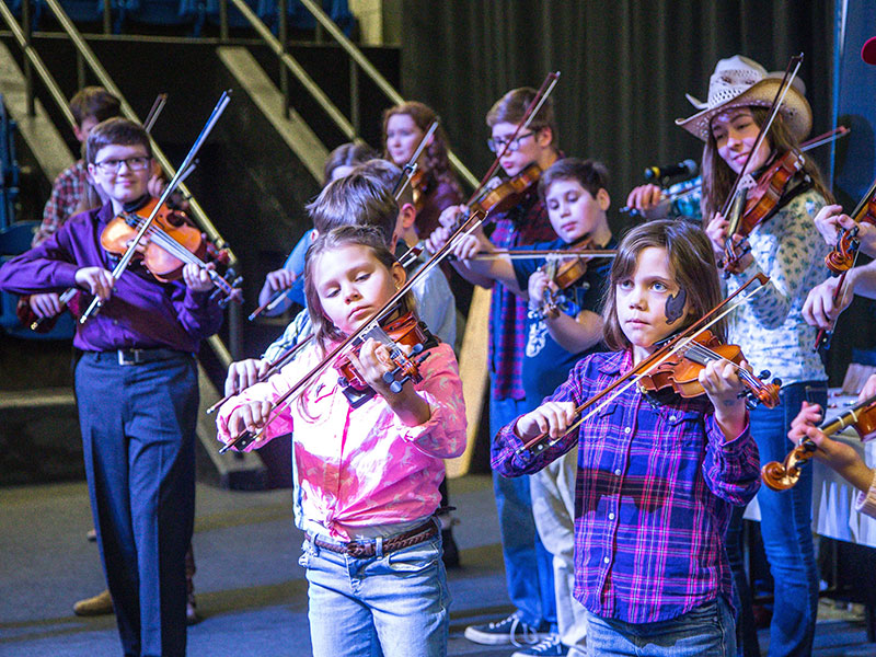 Young people compete on stage during the Royal Fiddlers' Contest at the Royal Manitoba Winter Fair, Brandon, Manitoba