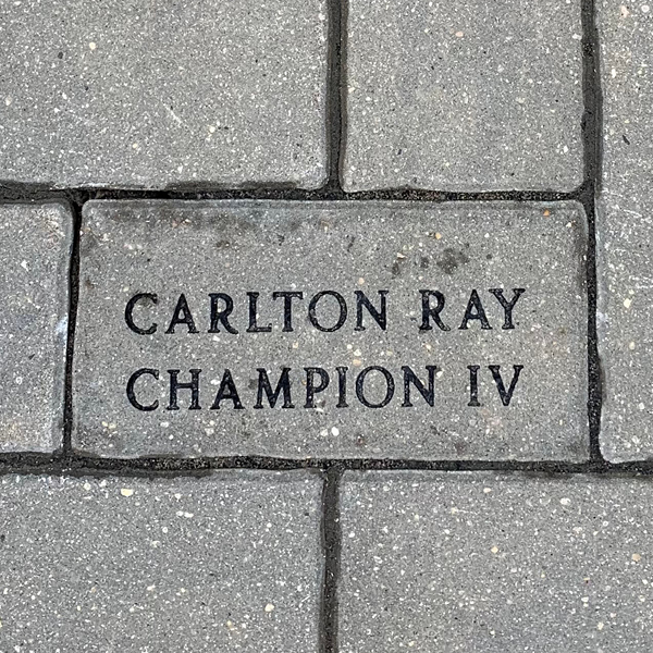 """Small personalized paving stone engraved with """"Carlton Ray Champion IV"""""""
